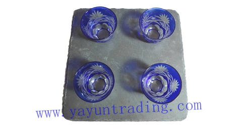 square slate platter with drinking tea cup