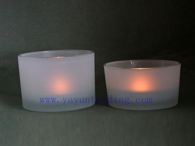 glass candle cup with candles